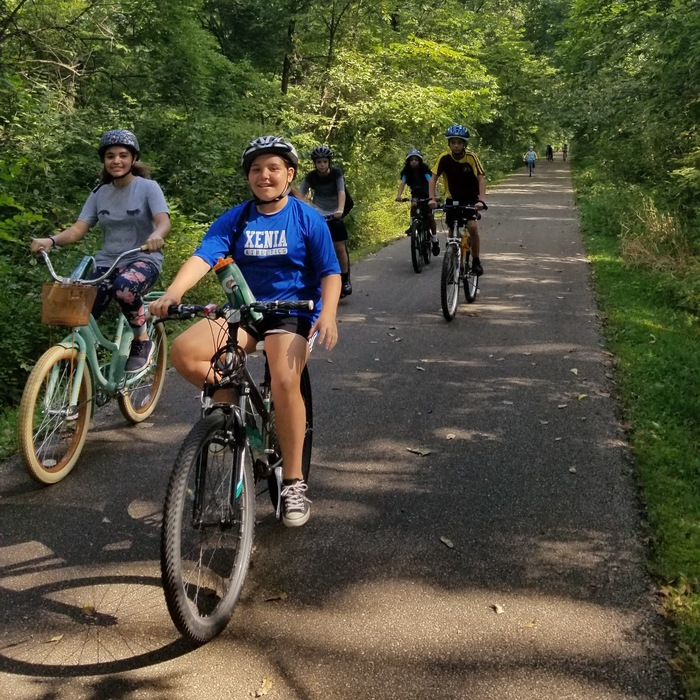 Pictures of 7th grade students on an Into the Wild training bike ride. 14 miles