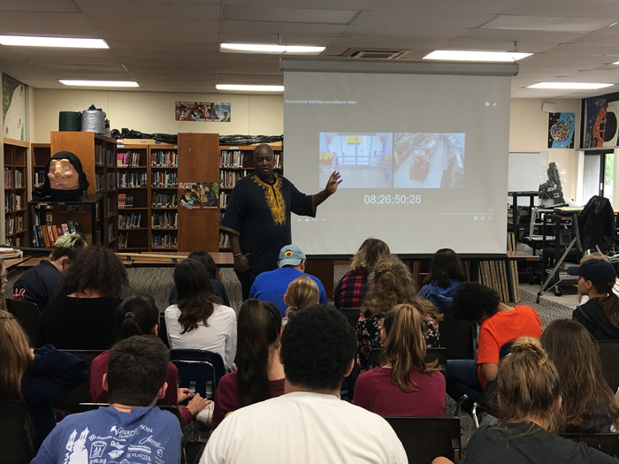 Bomani Moyenda speaking to our 8th grade students about the John Crawford case.