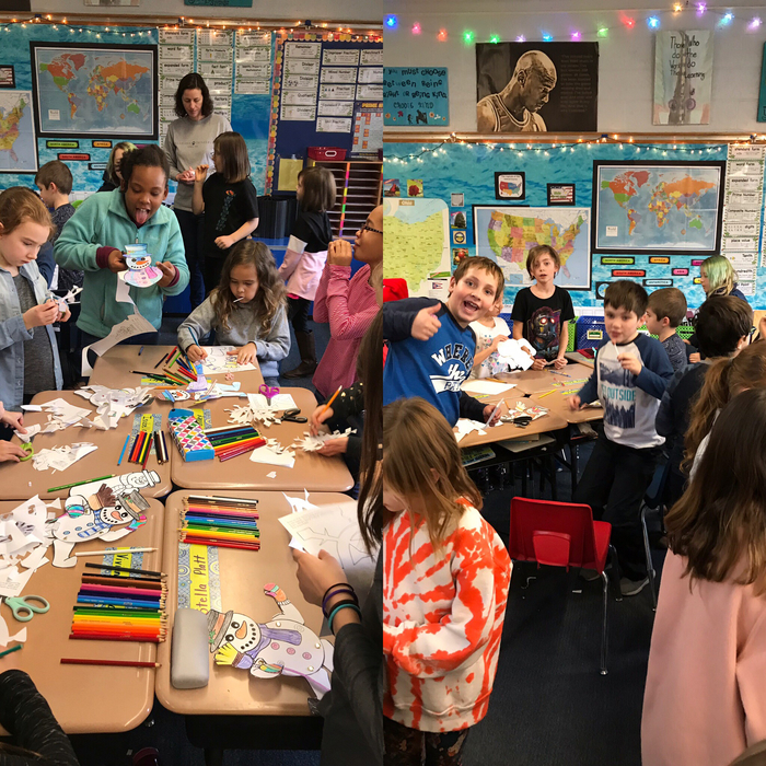 Second and fourth grade classes teamed up for a holiday buddy class activity.